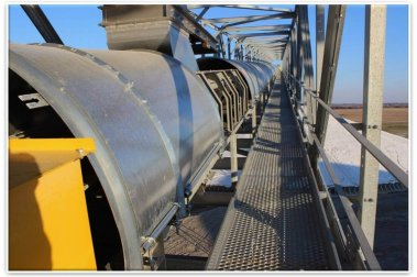 High capacity grain conveyor is set up at a manufacturing facility.