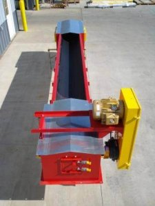 A round bottom conveyor sits outside of a manufacturing facility.