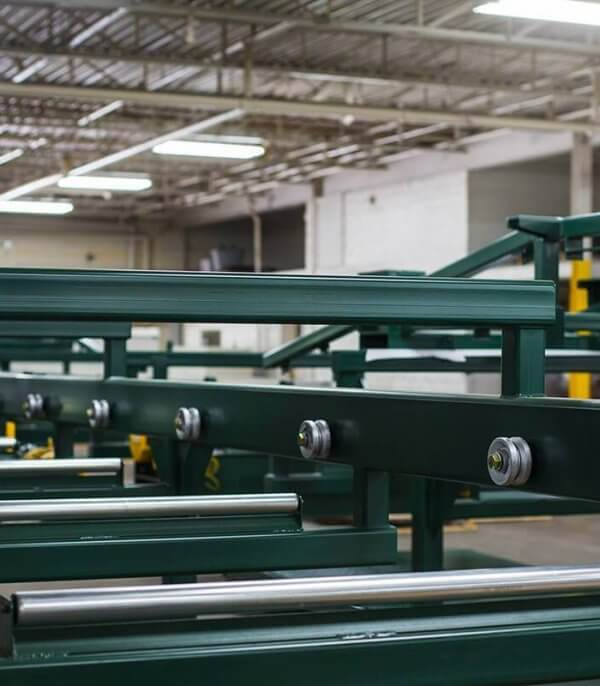 A picture of a custom-manufactured agriculture conveyor dries in the warehouse after a paint job.